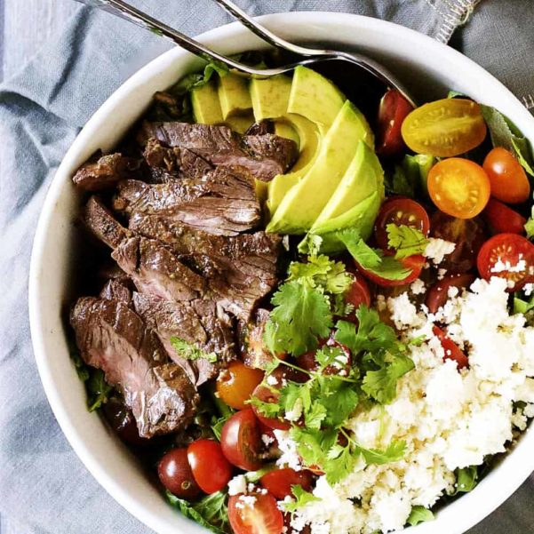carne-asada-steak-salad-served-in-a-white-bowl-square-image